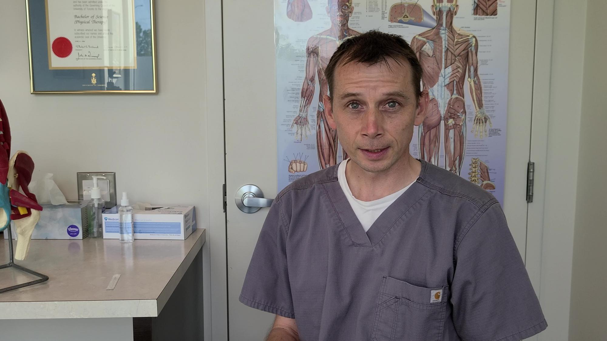 Rob Holmes, Calgary Physiotherapist, in his clinic